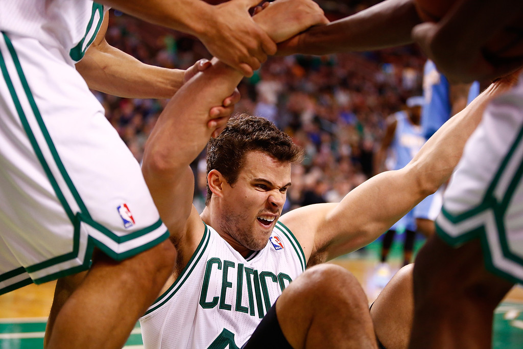 . BOSTON, MA - DECEMBER 06: Kris Humphries #43 of the Boston Celtics is helped up by his teammates following a dunk in the second quarter against the Denver Nuggets during the game at TD Garden on December 6, 2013 in Boston, Massachusetts.  (Photo by Jared Wickerham/Getty Images)