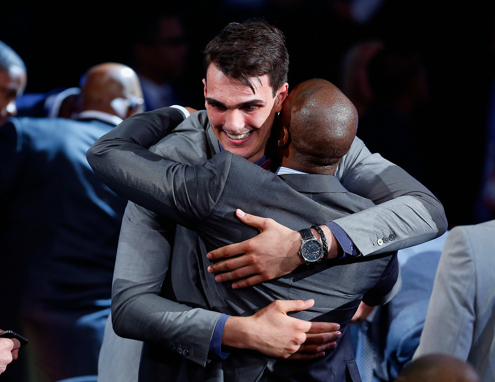 . Dario Saric of Croatia celebrates after being drafted with the #12 overall pick by the Orlando Magic during the 2014 NBA Draft at Barclays Center on June 26, 2014 in the Brooklyn borough of New York City. Saric was then traded to the Philadelphis 76ers.  (Photo by Mike Stobe/Getty Images)