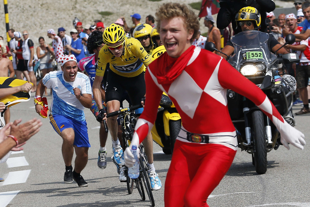 . Supporters cheer overall leader\'s yellow jersey Britain\'s Christopher Froome during the 242.5 km fifteenth stage of the 100th edition of the Tour de France cycling race on July 14, 2013 between Givors and Mont Ventoux, southeastern France.   JEFF PACHOUD/AFP/Getty Images