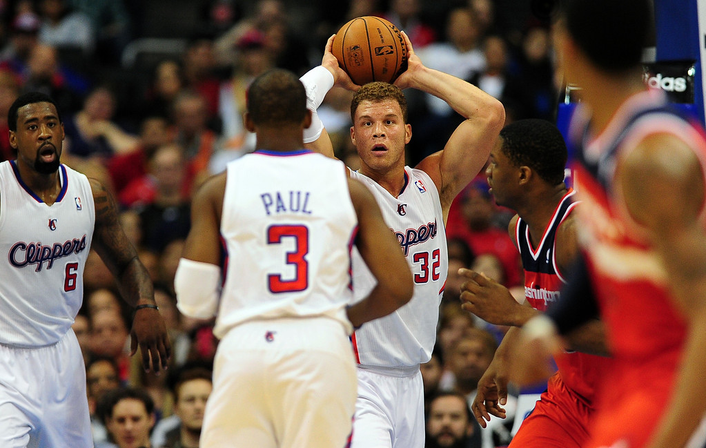 . Blake Griffin of the Los Angeles Clippers (C) looks to pass to teammate Chris Paul (#3) as the Clippers play the Washington Wizards (#42) during their NBA game in Los Angeles on January 19, 2013.  FREDERIC J. BROWN/AFP/Getty Images