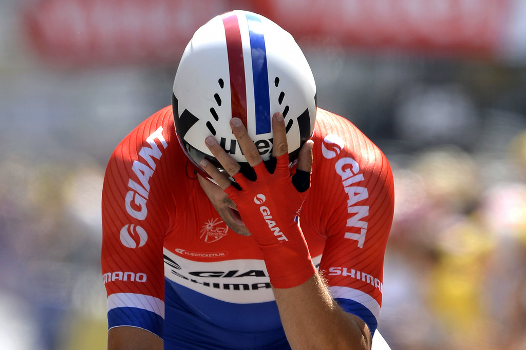 . Netherlands\' Tom Dumoulin reacts as he crosses the finish line at the end of the twentieth stage, a 54 km individual time trial, as part of the 101st edition of the Tour de France cycling race on July 26, 2014 between Bergerac and Perigueux, western France.  AFP PHOTO / ERIC  FEFERBERG/AFP/Getty Images