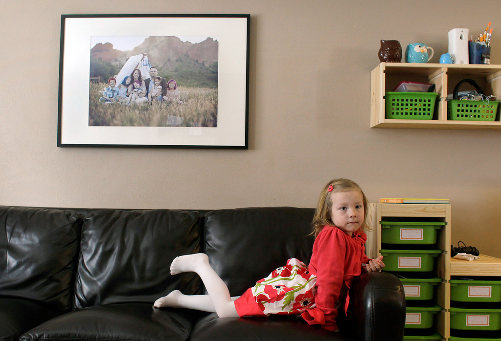 . In this Monday, Feb. 25, 2013, photo, Coy Mathis sits on a couch at her home in Fountain, Colo. (AP Photo/Brennan Linsley)