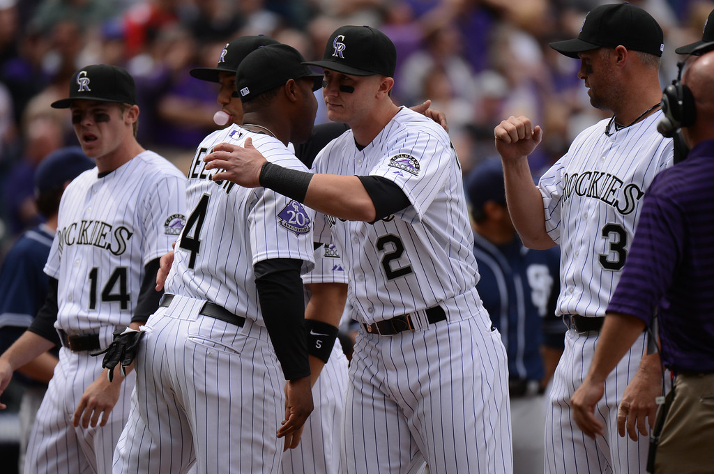 . Troy Tulowitzki (2) of the Colorado Rockies welcomes Chris Nelson (4) of the Colorado Rockies during the introductions. (Photo by Hyoung Chang/The Denver Post)