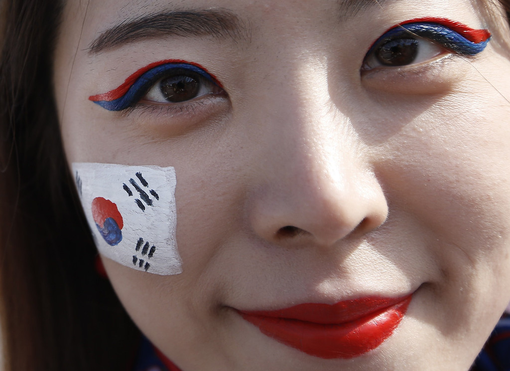 . A South Korea fan is pictured outside the stadium prior to a Group H football match between South Korea and Algeria at the Beira-Rio Stadium in Porto Alegre during the 2014 FIFA World Cup on June 22, 2014.      ADRIAN DENNIS/AFP/Getty Images