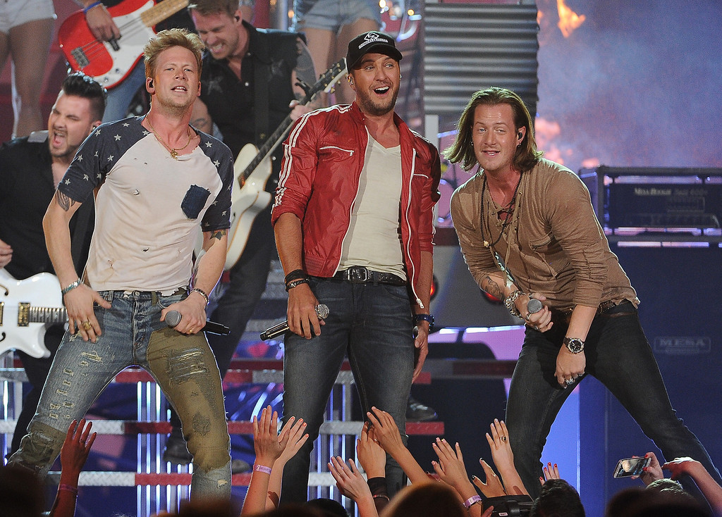 . Luke Bryan, center, and from left, Brian Kelley and Tyler Hubbard, of the musical group Florida Georgia Line, perform at the Billboard Music Awards at the MGM Grand Garden Arena on Sunday, May 18, 2014, in Las Vegas. (Photo by Chris Pizzello/Invision/AP)