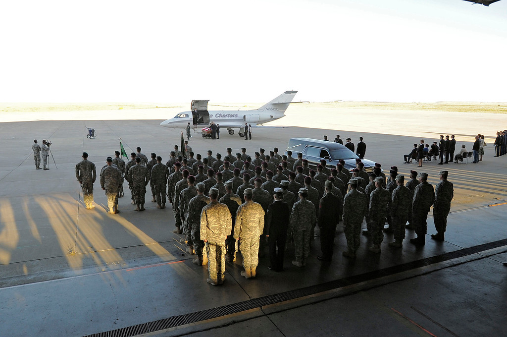 . Green Beret and Airborne salute one of their own as military officials brought the body of special forces staff sergeant Liam Nevins, 32, home from Dover AFB September 30, 2013 at Buckley AFB. Nevins, of Denver, was killed two weekends ago in Afghanistan. (Photo by John Leyba/The Denver Post)