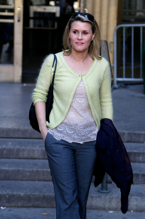 """. In this April 8, 2013 file photo, Canadian actress Genevieve Sabourin leaves court in New York. Sabourin was convicted in November 2013 of stalking Baldwin with emails, phone calls, and unsolicited visits to his Manhattan apartment. Sabourian and Baldwin met in 2000 on a movie set and had dinner a decade later, and the actress said Baldwin made promises of a life together. The judge who sentenced her said no matter what happened between the two, Sabourin had no right to pursue contact she knew to be unwanted and amounted to a \""""relentless and escalating campaign of threats and in-person appearances.\"""" (AP Photo/Seth Wenig, file)"""