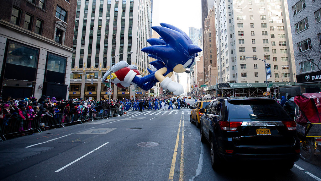 . A giant Sonic the Hedgehog balloon is marched down 6th Avenue during the 87th Annual Macy\'s Thanksgiving Day Parade, Thursday, Nov. 28, 2013, in New York. After fears the balloons could be grounded if sustained winds exceeded 23 mph, Snoopy, Spider-Man and the rest of the iconic balloons received the all-clear from the New York Police Department to fly between Manhattan skyscrapers on Thursday. (AP Photo/John Minchillo)