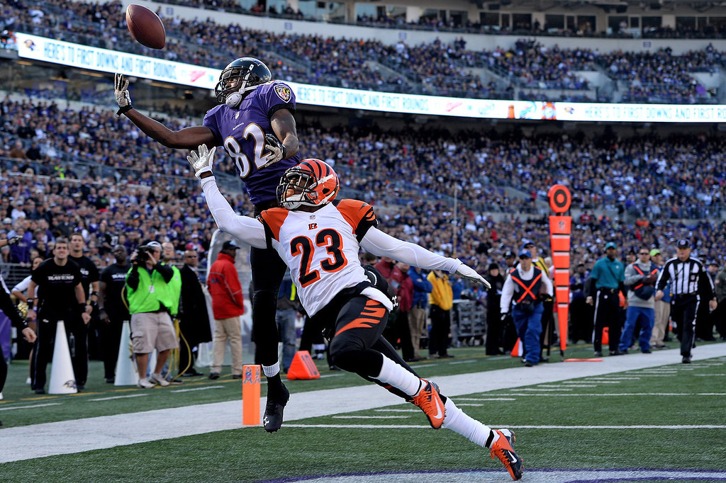. Wide receiver Torrey Smith #82 of the Baltimore Ravens tries to catch a pass as he is defended by cornerback Terence Newman #23 of the Cincinnati Bengals in the first quarter at M&T Bank Stadium on November 10, 2013 in Baltimore, Maryland. (Photo by Patrick Smith/Getty Images)