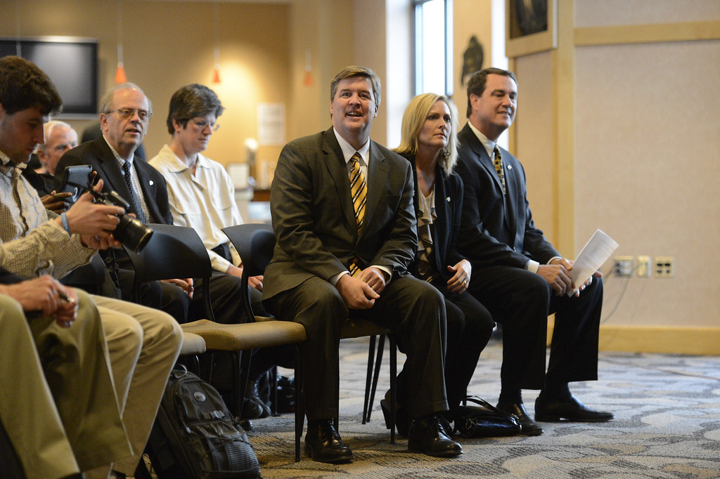 . The University of Colorado athletic director MIke Bohn sits with new head football coach Mike MacIntyre and his wife Trisha MacIntyre during  a press conference Monday, December 10, 2012  at the Byron White Club Room at Folsom Field. MacIntyre will be the 25th full-time head football coach in the CU history as he comes from San Jose State. John Leyba, The Denver Post