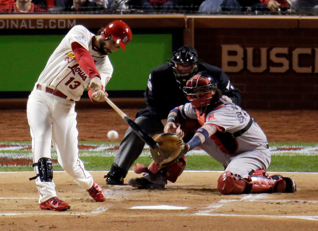 . St. Louis Cardinals\' Matt Carpenter hits a single during the first inning of Game 3 of baseball\'s World Series against the Boston Red Sox Saturday, Oct. 26, 2013, in St. Louis. (AP Photo/Charlie Riedel)