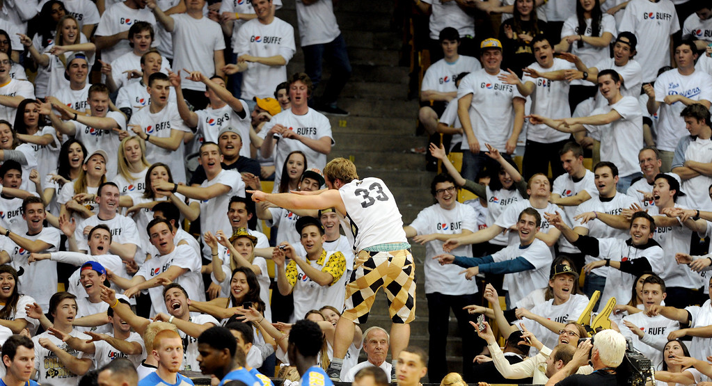 . The CU fans do the roller coaster before the second half of the January 16, 2014 game in Boulder.  (Cliff Grassmick/Daily Camera)
