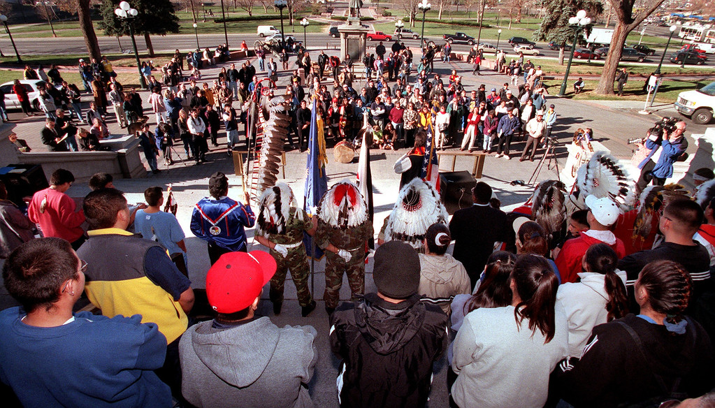 . Color guard members of the American Legion Post 84 ( middle of photo), from Arapahoe, Wyoming, are surrounded by  leaders and elders of the Northern Cheyenne Tribe and other  tribes during the 135th anniversary of the Sand Creek Massacre  Monday morning on the west steps of the State Capital in Denver, Colorado on November 29, 1999.  Runners took part in a 170 mile spiritual healing run from the  site of the massacre to the Capital. (LEW SHERMAN/THE DENVER POST)