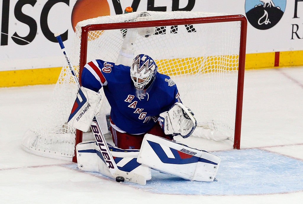 . Henrik Lundqvist #30 of the New York Rangers makes a save against the Los Angeles Kings during the second period of Game Four of the 2014 NHL Stanley Cup Final at Madison Square Garden on June 11, 2014 in New York, New York.  (Photo by Paul Bereswill/Getty Images)