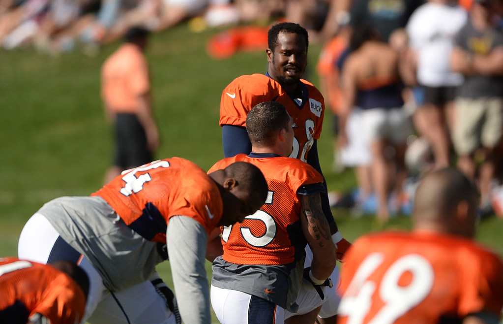 . CENTENNIAL, CO. - August 10: Von Miller of the Denver Broncos (58), top, warms up for the training camp at Dove Valley. Centennial, Colorado. August 10, 2013. (Photo By Hyoung Chang/The Denver Post)