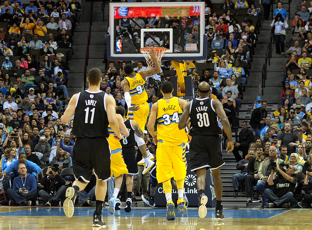 . DENVER, CO. - MARCH 29: Andre Iguodala (9) of the Denver Nuggets finished a fast break with a dunk in the second half. The Denver Nuggets defeated the Brooklyn Nets 109-87 Friday night, March 29, 2013 at the Pepsi Center in Denver.  (Photo By Karl Gehring/The Denver Post)