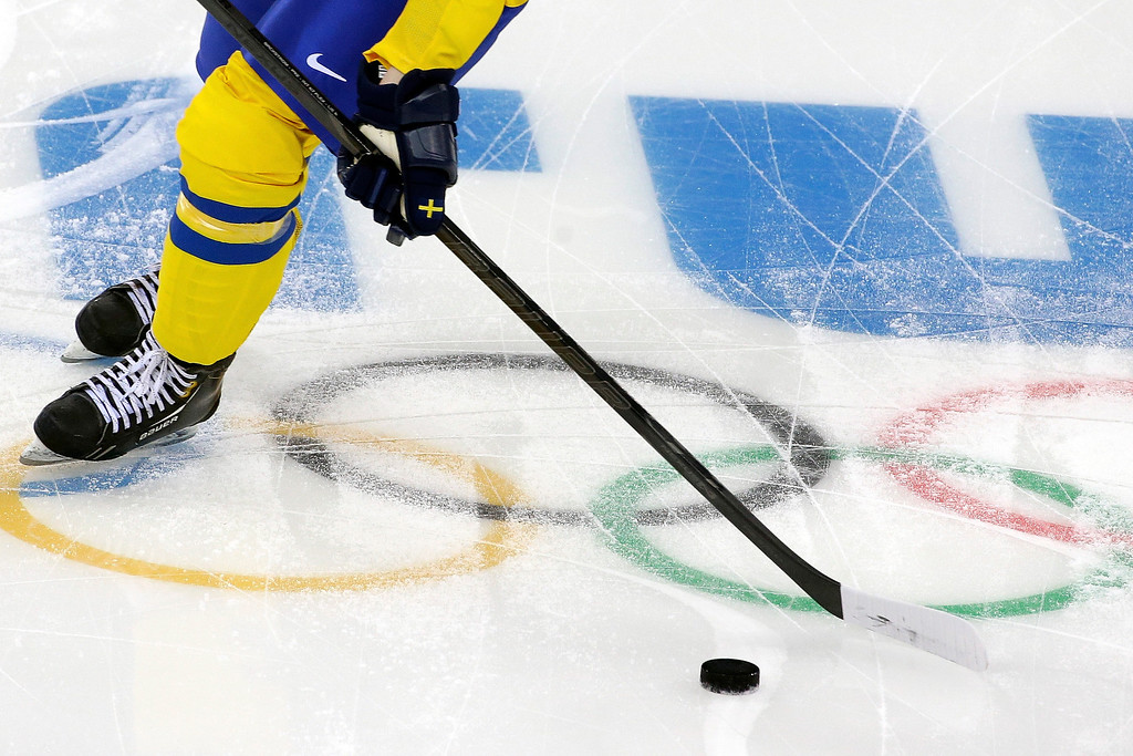 . Lina Backlin of Sweden moves the puck over the Olympic Rings during the warm up period before playing Japan during the 2014 Winter Olympics women\'s ice hockey game at Shayba Arena, Sunday, Feb. 9, 2014, in Sochi, Russia. (AP Photo/Matt Slocum)