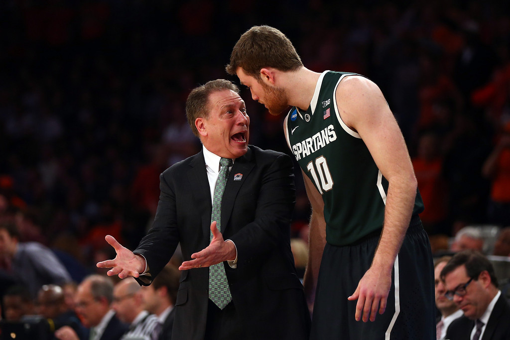 . Head coach Tom Izzo of the Michigan State Spartans talks with Matt Costello #10 during the regional semifinal of the 2014 NCAA Men\'s Basketball Tournament at Madison Square Garden on March 28, 2014 in New York City.  (Photo by Elsa/Getty Images)