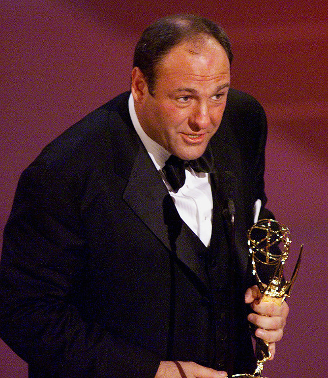 """. Actor James Gandolfini accepts his trophy for the \""""Lead Actor in a Drama Series\"""" category for his role in \""""The Sopranos\"""" during the 52nd Annual Primetime Emmy Awards at the Shrine Auditorium in Los Angeles 10 September, 2000.  LUCY NICHOLSON/AFP/Getty Images"""