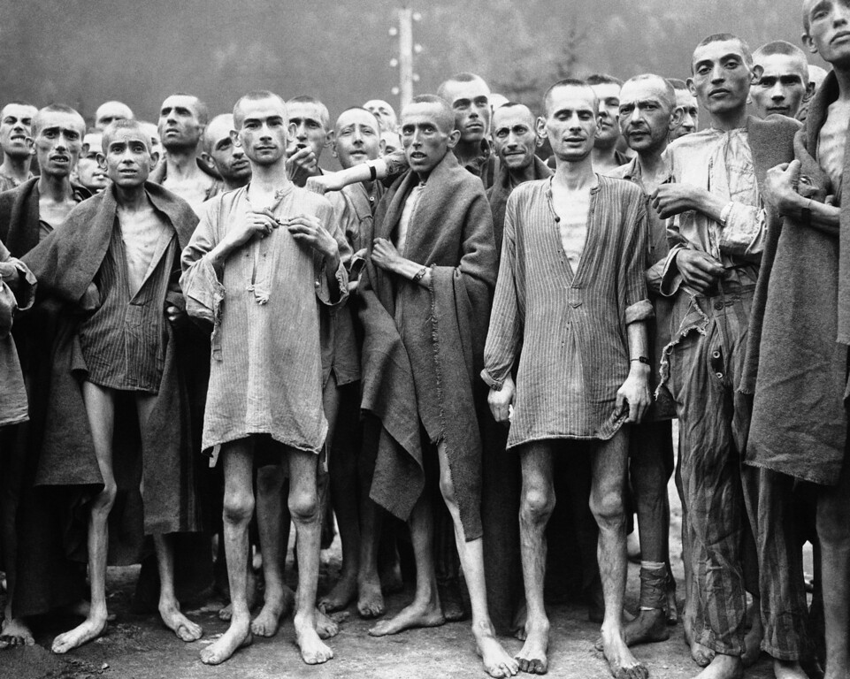 ". Starved prisonerís, nearly dead from hunger, at one of the largest Nazi Concentration camps at Evensee Austria, in the Austrian Alps, May 7, 1945. Many were starving to death and inmates were dying at the rate of 2,000 per week. The camp was reputedly used for ""Scientific\"" experiments. It was liberated by the 80th Division, U.S. Third Army. (AP Photo)"