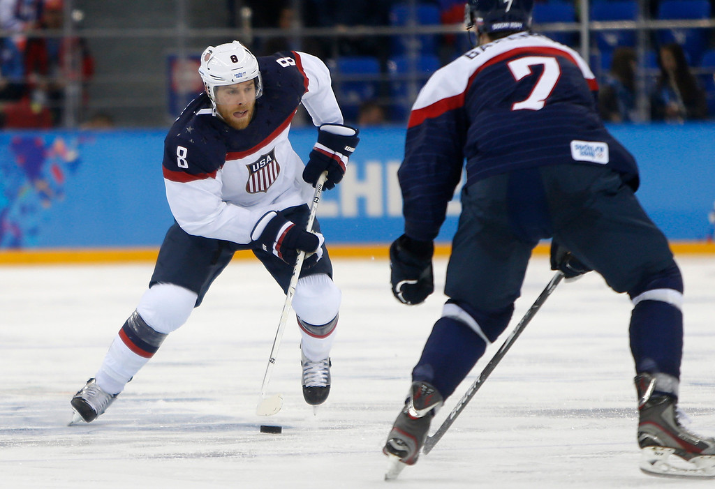 . USA\'s Joe Pavelski (8) controls the puck against Slovakia\'s Ivan Baranka (7) in the second period for their preliminary round at the Shayba Arena for the 2014 Winter Olympics in Sochi, Russia on Thursday, Feb. 13, 2014.  (Nhat V. Meyer/Bay Area News Group)