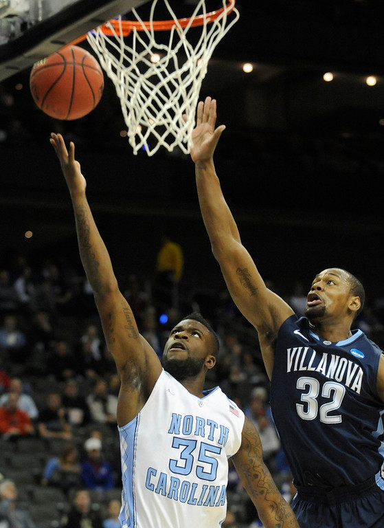 . North Carolina Tar Heels\' Reggie Bullock (L) shoots under Villanova Wildcats guard James Bell during the first half of the second round of the NCAA men\'s basketball tournament at the Sprint Center in Kansas City, Missouri, March 22, 2013. REUTERS/Dave Kaup