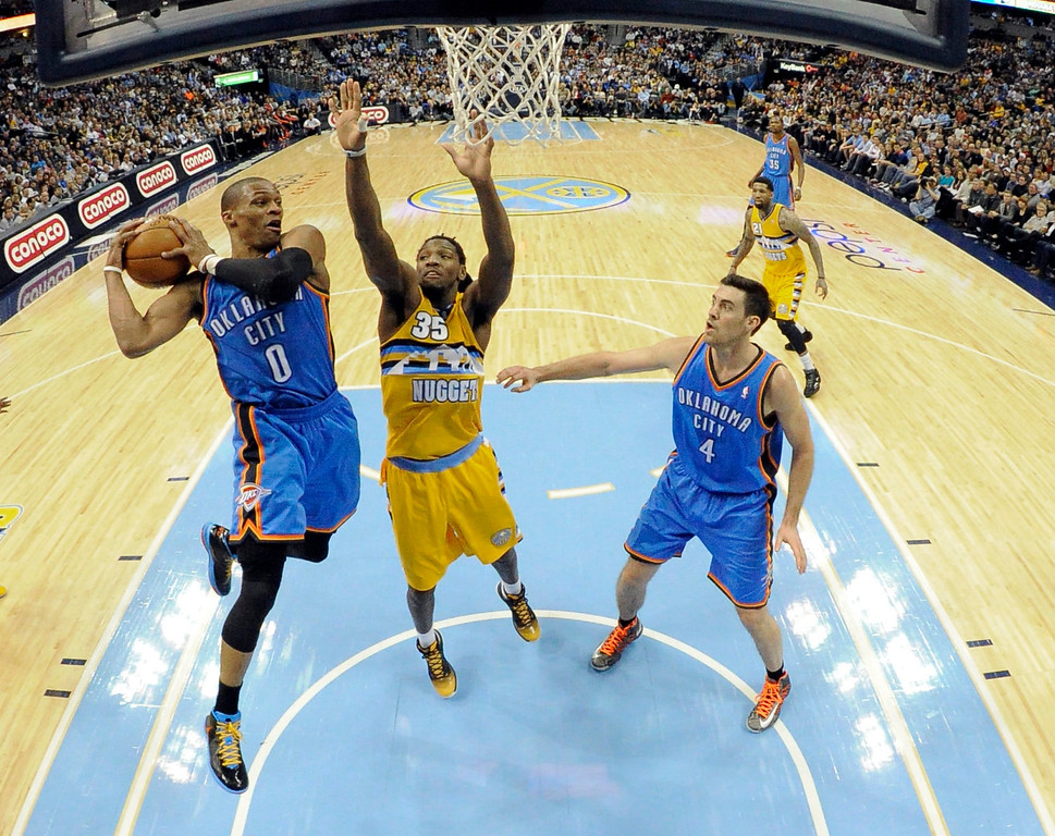 . DENVER, CO. - JANUARY 20: Oklahoma City Thunder point guard Russell Westbrook (0) drives to the basket on Denver Nuggets small forward Kenneth Faried (35) third quarter January 20,  2013 at Pepsi Center. The Denver Nuggets defeated the Oklahoma City Thunder 121-118. (Photo By John Leyba / The Denver Post)