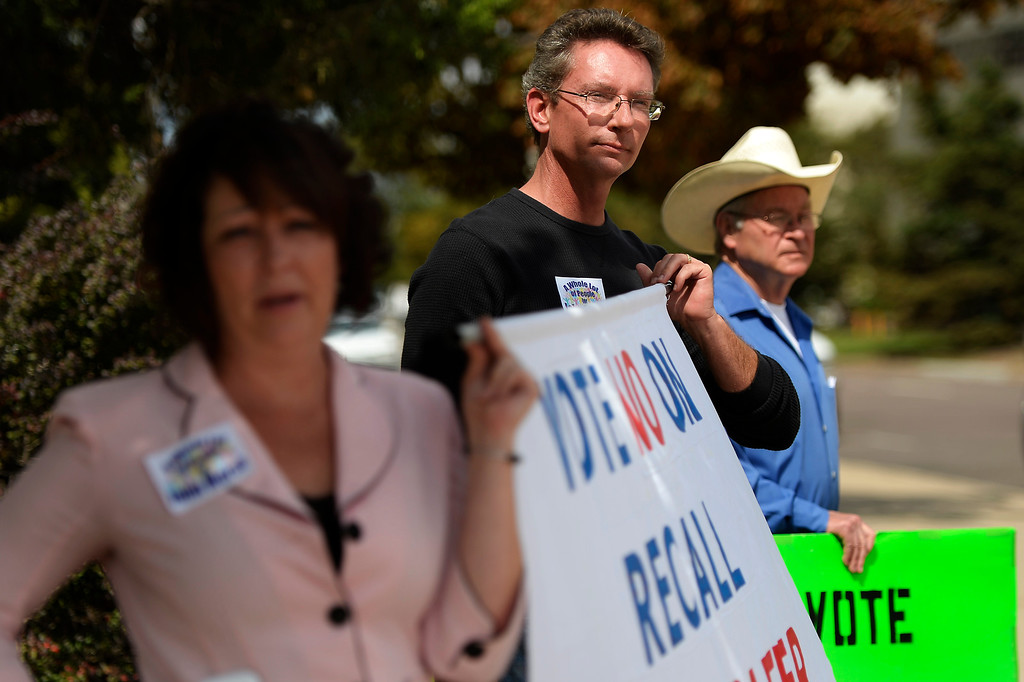 . COLORADO SPRINGS, CO. - September 10: Richard Morse (center) supports his brother Senate President John Morse during the recall vote at the Centennial Building in downtown September 10, 2013 Colorado Springs, Colorado. (Photo By Joe Amon/The Denver Post)