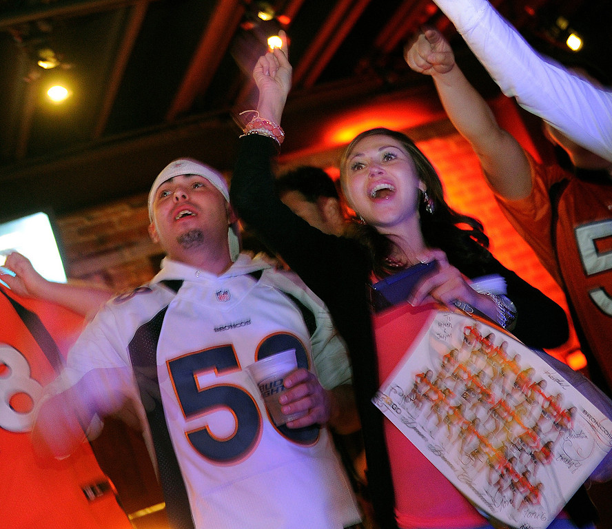. Broncos fans showed their team spirit during a draft night party Thursday. With the 28th pick Denver picked Sylvester Williams from North Carolina. Broncos fans gathered for a NFL draft party at the Tavern Downtown, 1949 Market Street, Thursday night, April 25, 2013. Photo By Karl Gehring/The Denver Post