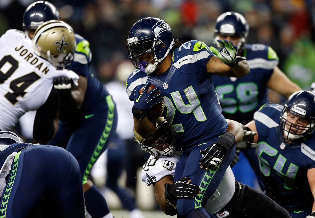 . Running back Marshawn Lynch #24 of the Seattle Seahawks carries the ball against the New Orleans Saints during a game at CenturyLink Field on December 2, 2013 in Seattle, Washington.  (Photo by Otto Greule Jr/Getty Images)
