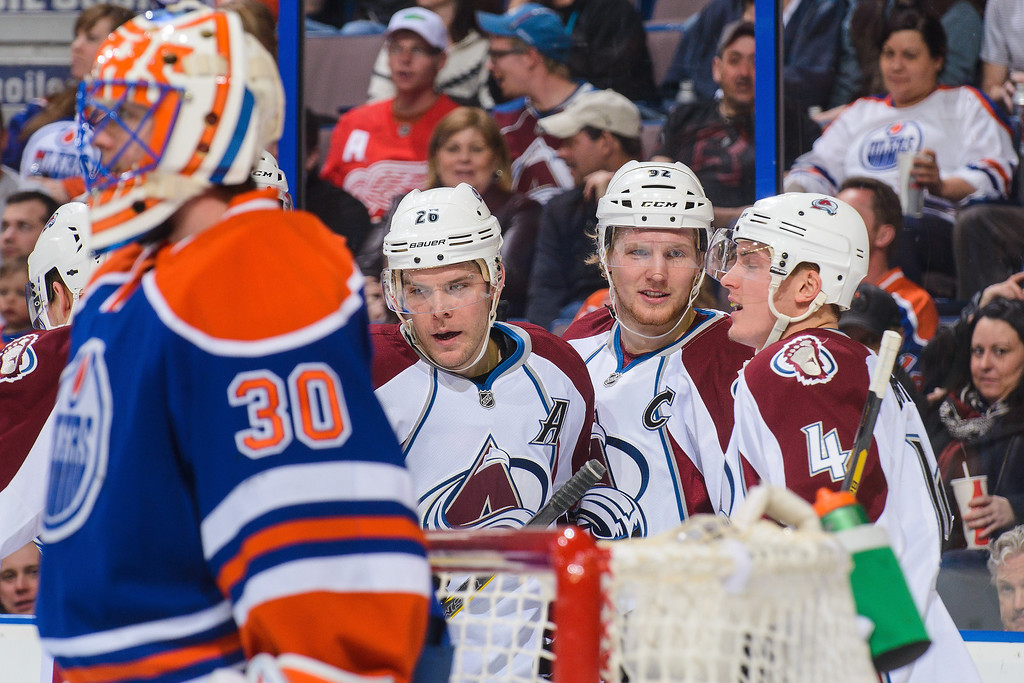. (L to R) Paul Stastny #26, Gabriel Landeskog #92, and Tyson Barrie #4 of the Colorado Avalanche celebrate Paul Stastny\'s goal against Ben Scrivens #30 of the Edmonton Oilers during an NHL game at Rexall Place on April 8, 2014 in Edmonton, Alberta, Canada. (Photo by Derek Leung/Getty Images)