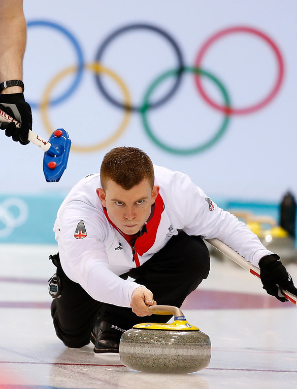 . Great Britain\'s Greg Drummond delivers the rock during men\'s curling competition against Russia at the 2014 Winter Olympics, Monday, Feb. 10, 2014, in Sochi, Russia. (AP Photo/Robert F. Bukaty)