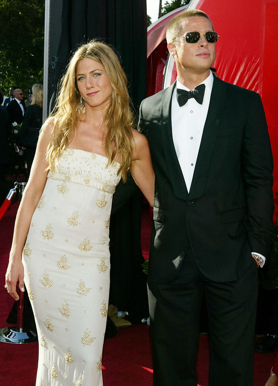 . Actors Jennifer Aniston and husband Brad Pitt attend the 56th Annual Primetime Emmy Awards at the Shrine Auditorium September 19, 2004 in Los Angeles, California.  (Photo by Kevin Winter/Getty Images)