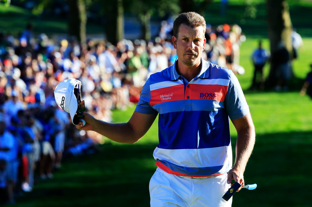 . ROCHESTER, NY - AUGUST 10:  Henrik Stenson of Sweden waves to the gallery on the 18th green after a one-under par 69 during the third round of the 95th PGA Championship on August 10, 2013 in Rochester, New York.  (Photo by Sam Greenwood/Getty Images)