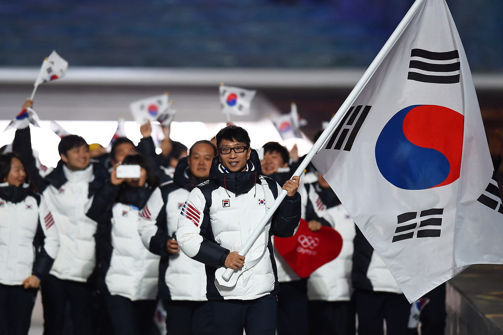 . Speed skater Kyou Hyuk Lee of the South Korea Olympic team carries his country\'s flag during the Opening Ceremony of the Sochi 2014 Winter Olympics at Fisht Olympic Stadium on February 7, 2014 in Sochi, Russia.  (Photo by Pascal Le Segretain/Getty Images)