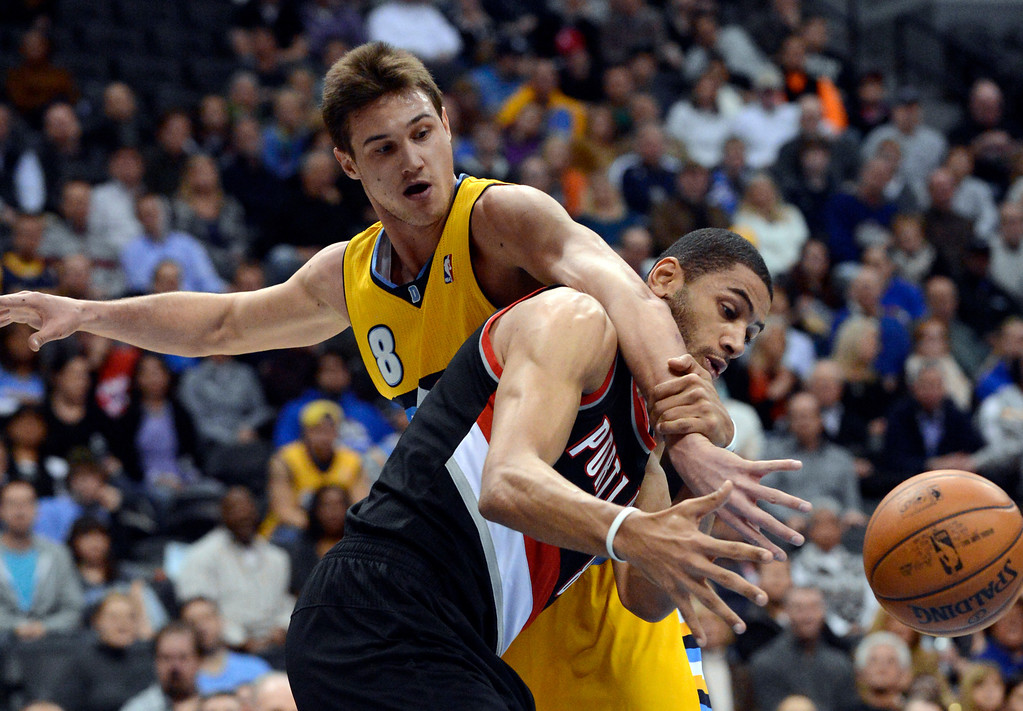 . Denver Nuggets small forward Danilo Gallinari (8) battles for a rebound with Portland Trail Blazers small forward Nicolas Batum (88) during the first quarter Tuesday, January 15, 2013, at Pepsi Center. John Leyba, The Denver Post