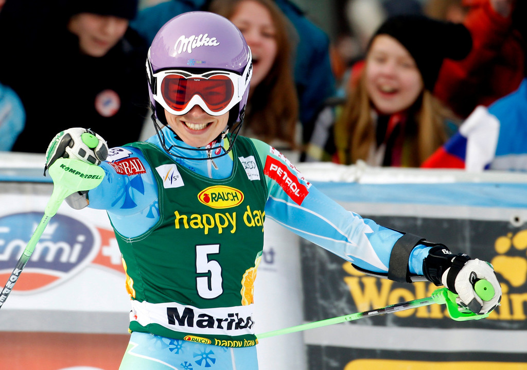 . Slovenia\'s Tina Maze celebrates after winning an alpine ski, women\'s world Cup slalom, in Maribor, Slovenia, Sunday, Jan. 27, 2013. Overall World Cup leader Tina Maze rebounded from a close loss by posting an emphatic slalom victory before her home fans Sunday. Maze, who lost Saturday\'s giant slalom by 0.08 seconds to Lindsey Vonn, led after the opening run and clocked a two-run combined time of 1 minute, 33.68 seconds down the Radvanje course. (AP Photo/Pier Marco Tacca)