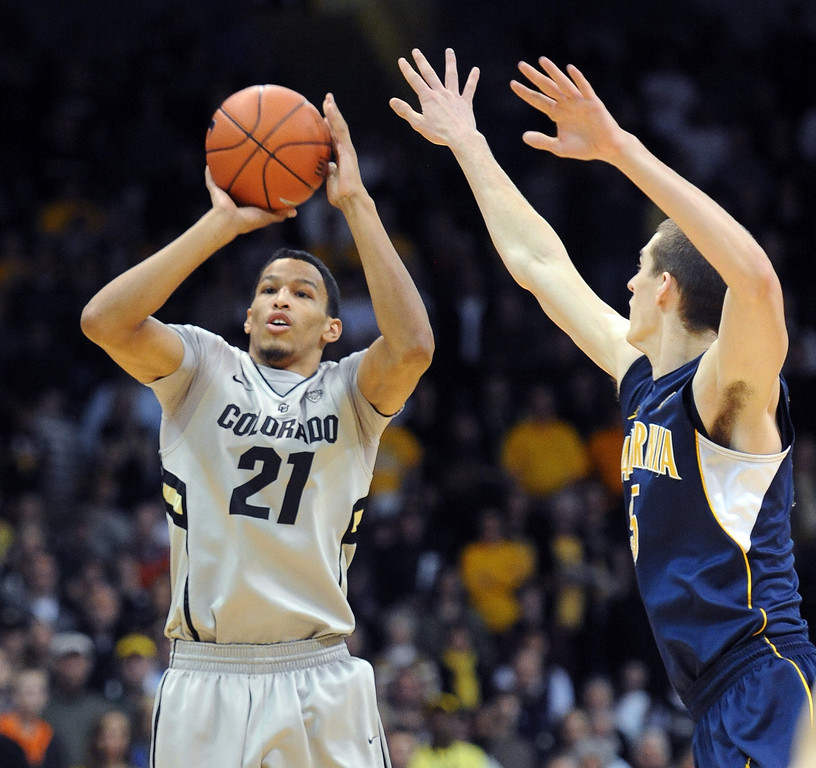 . Andre Roberson of CU shoots past David Kravish of Cal during the first half of the January 27th, 2013 game in Boulder. Cliff Grassmick/The Daily Camera
