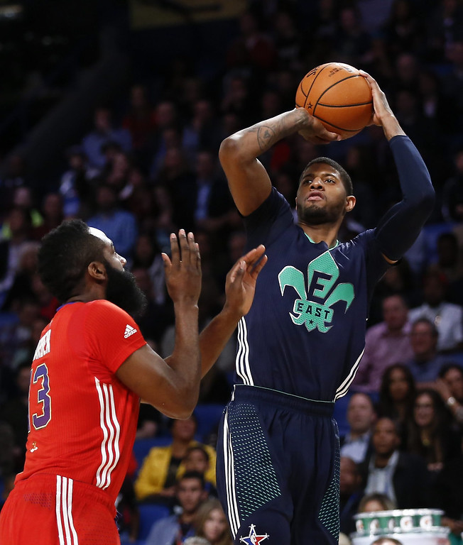 . Eastern Conference guard Kyrie Irving (R) shoots over Western Conference guard James Harden (L) during the 63rd NBA All-Star Game in New Orleans, Louisiana.  EPA/PAUL BUCK
