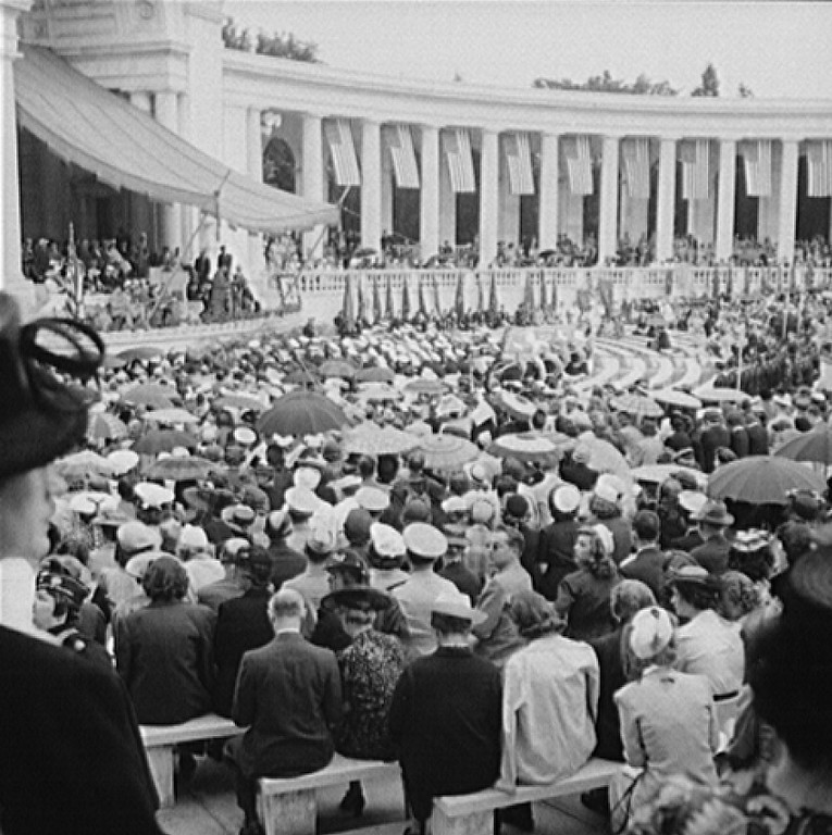 . Arlington Cemetery, Arlington, Virginia. Spectators putting up umbrellas as a light rain starts falling at the Memorial Day services in the amphitheater. Esther Bubley, Photographer.  Courtesy the Library of Congress