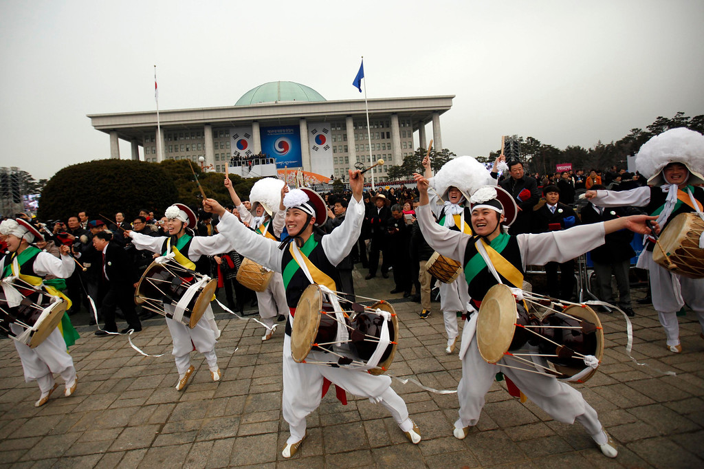 ". Members of a ""Samulnori\"" dance troupe, or traditional South Korean percussion assemble, perform during the inauguration of South Korea\'s new President Park Geun-hye (not pictured) at parliament in Seoul February 25, 2013.  REUTERS/Kim Hong-Ji"