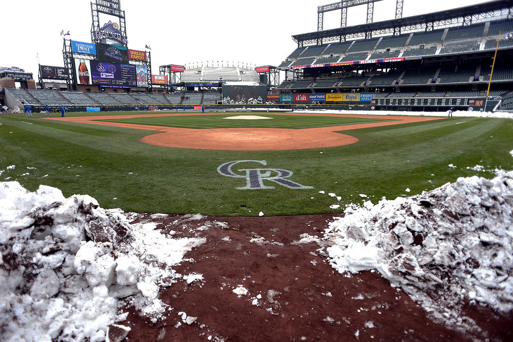 . Snow covers the field as the Colorado Rockies New York Mets will play a double header April 16, 2013 at Coors Field. (Photo By John Leyba/The Denver Post)
