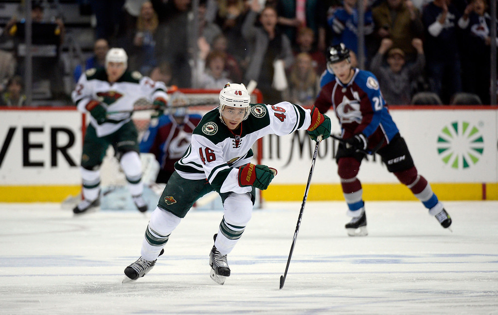 . Jared Spurgeon (46) of the Minnesota Wild chases the puck down ice during the first period of action.  (Photo by John Leyba/The Denver Post)