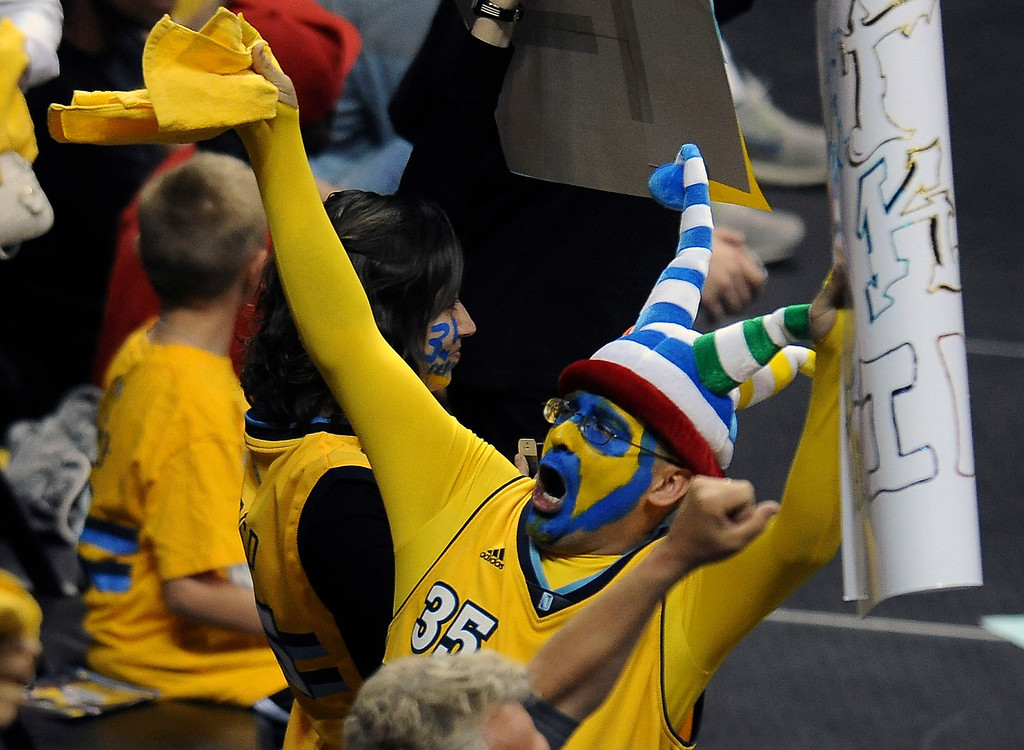 . Floyd Martinez of Brighton celebrates as the Nuggets made a run in the second half. The Denver Nuggets took on the Golden State Warriors in Game 5 of the Western Conference First Round Series at the Pepsi Center in Denver, Colo. on April 30, 2013. (Photo by Steve Nehf/The Denver Post)