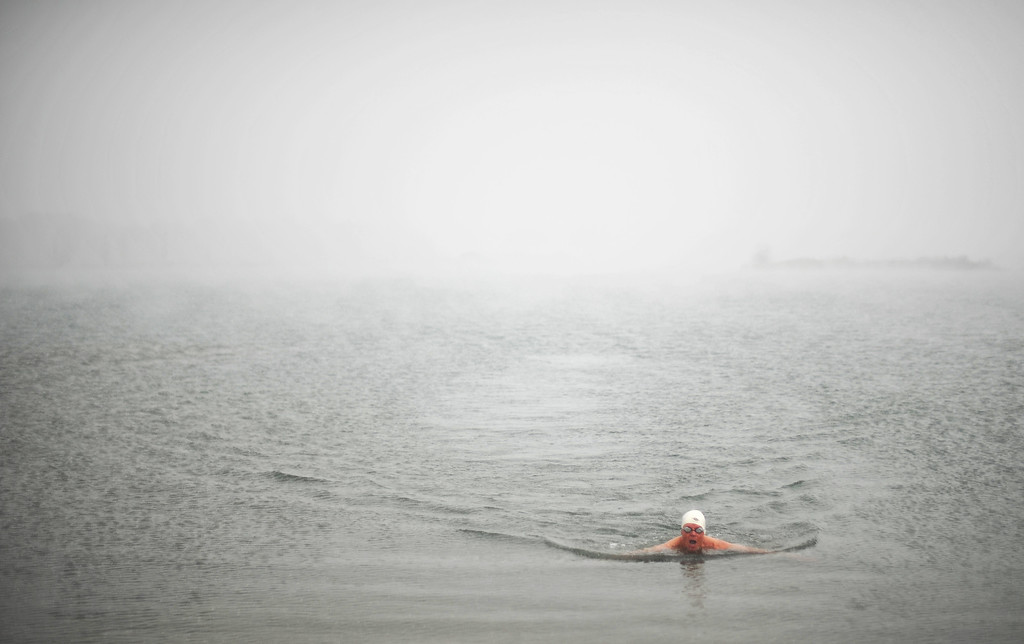 . LITTLETON, CO. - MAY 01 : Jeffrey Hulett of Golden is swimming. Four swimmers from Colorado Masters Swimming Association are swimming at the Gravel Pond in Chatfield State Park for the opening day of the open water swimming season. Littleton, Colorado. May 1, 2013. (Photo By Hyoung Chang/The Denver Post)