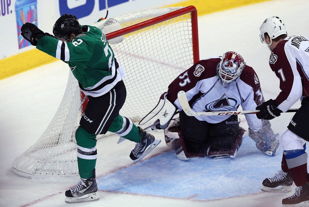 . Colton Sceviour #22 of the Dallas Stars scores a goal against Jean-Sebastien Giguere #35 of the Colorado Avalanche in the third period at American Airlines Center on December 17, 2013 in Dallas, Texas.  (Photo by Ronald Martinez/Getty Images)