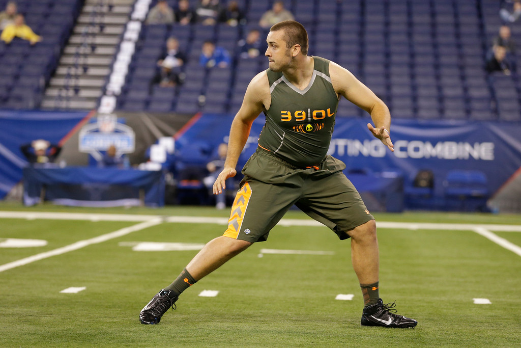 . Michigan offensive lineman Michael Schofield runs a drill at the NFL football scouting combine in Indianapolis, Saturday, Feb. 22, 2014. (AP Photo/Michael Conroy)