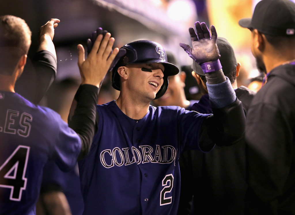 . Troy Tulowitzki #2 of the Colorado Rockies celebrates his two run home run off of Shawn Tolleson #37 of the Texas Rangers to give the Rockies a 7-1 lead in the seventh inning during Interleague play at Coors Field on May 5, 2014 in Denver, Colorado.  (Photo by Doug Pensinger/Getty Images)