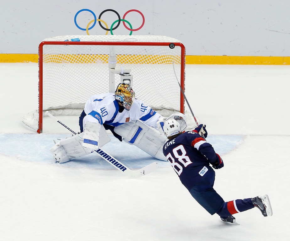 . USA forward Patrick Kane hits the post as he shoots on Finland goaltender Tuukka Rask during the second period of the men\'s bronze medal ice hockey game at the 2014 Winter Olympics, Saturday, Feb. 22, 2014, in Sochi, Russia. (AP Photo/David J. Phillip  )