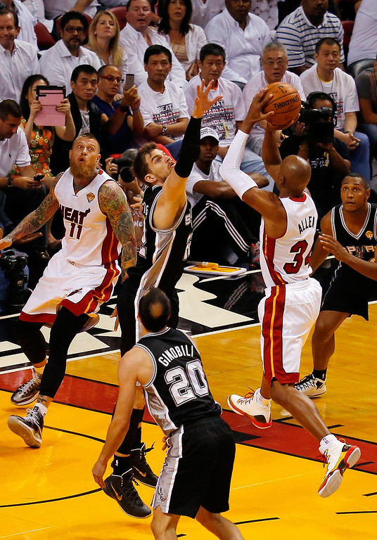 . MIAMI, FL - JUNE 10:  Ray Allen #34 of the Miami Heat takes a shot against Tiago Splitter #22 of the San Antonio Spurs during Game Three of the 2014 NBA Finals at American Airlines Arena on June 10, 2014 in Miami, Florida.  (Photo by Chris Trotman/Getty Images)